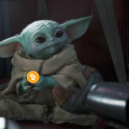the-child-holds-bitcoin